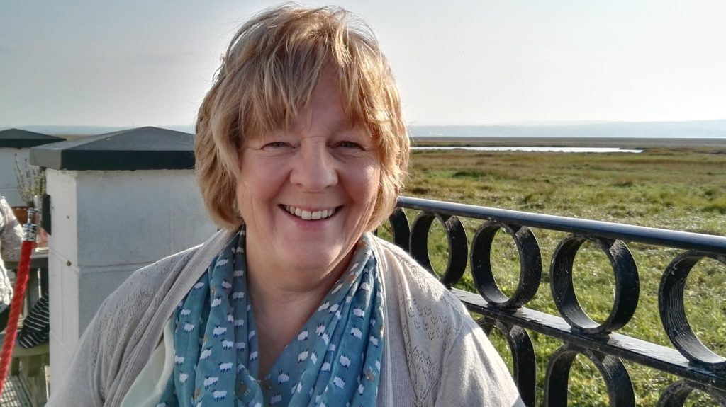 Margaret Roy at The Boathouse in Parkgate with the Dee estuary in the background